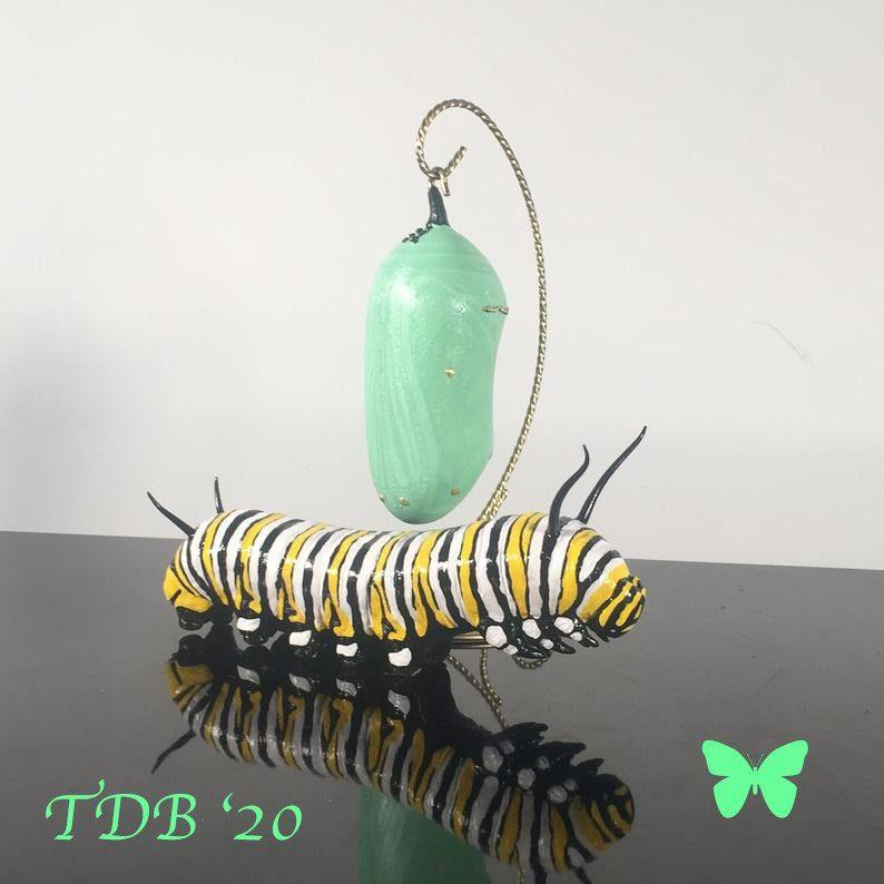 caterpillar green chrysalis sculptures